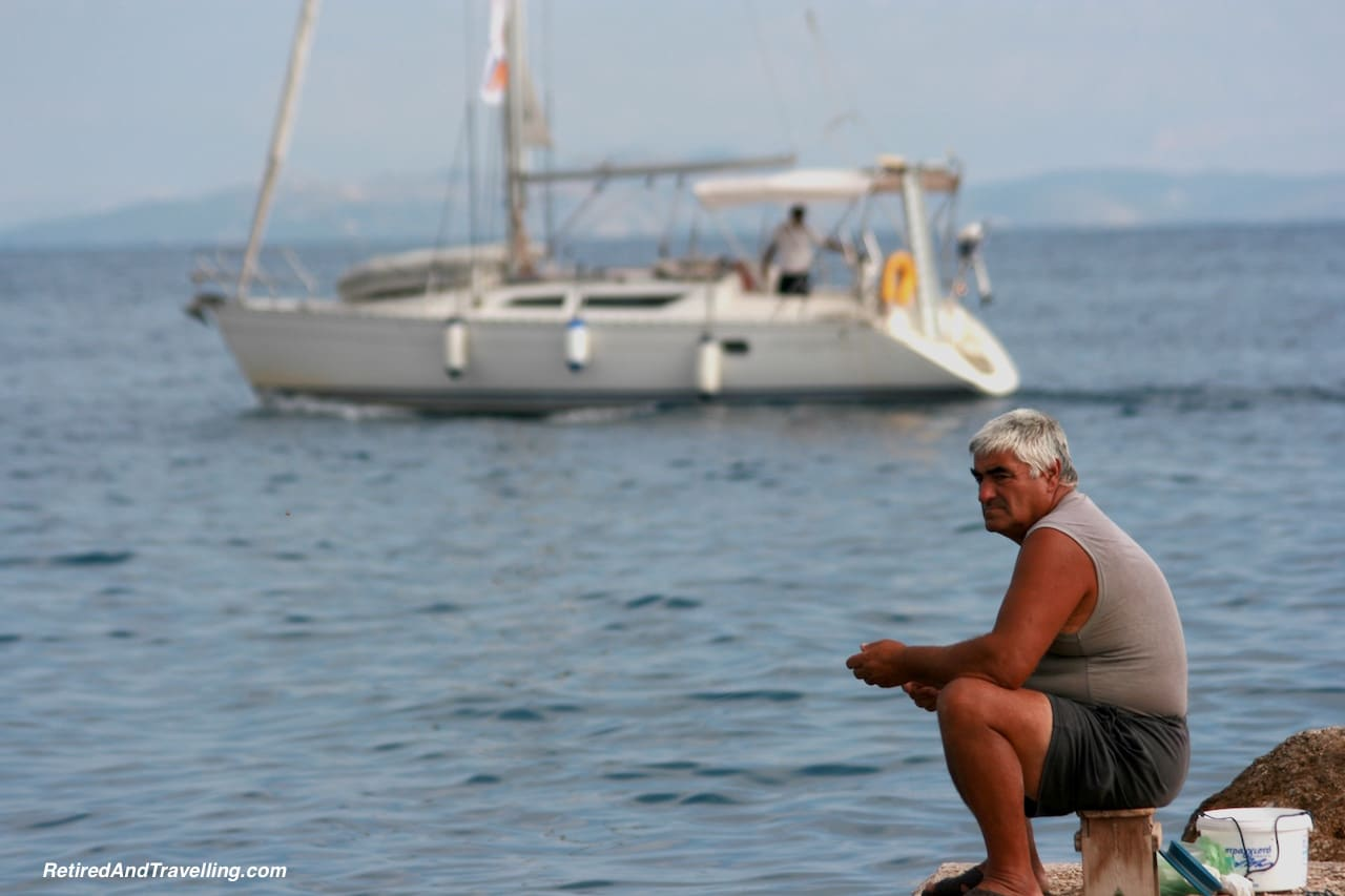 Corfu Fisherman - Exploring Greek Islands.jpg