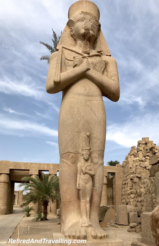 Ramses II Statues - Karnak Temple Day and Night.jpg