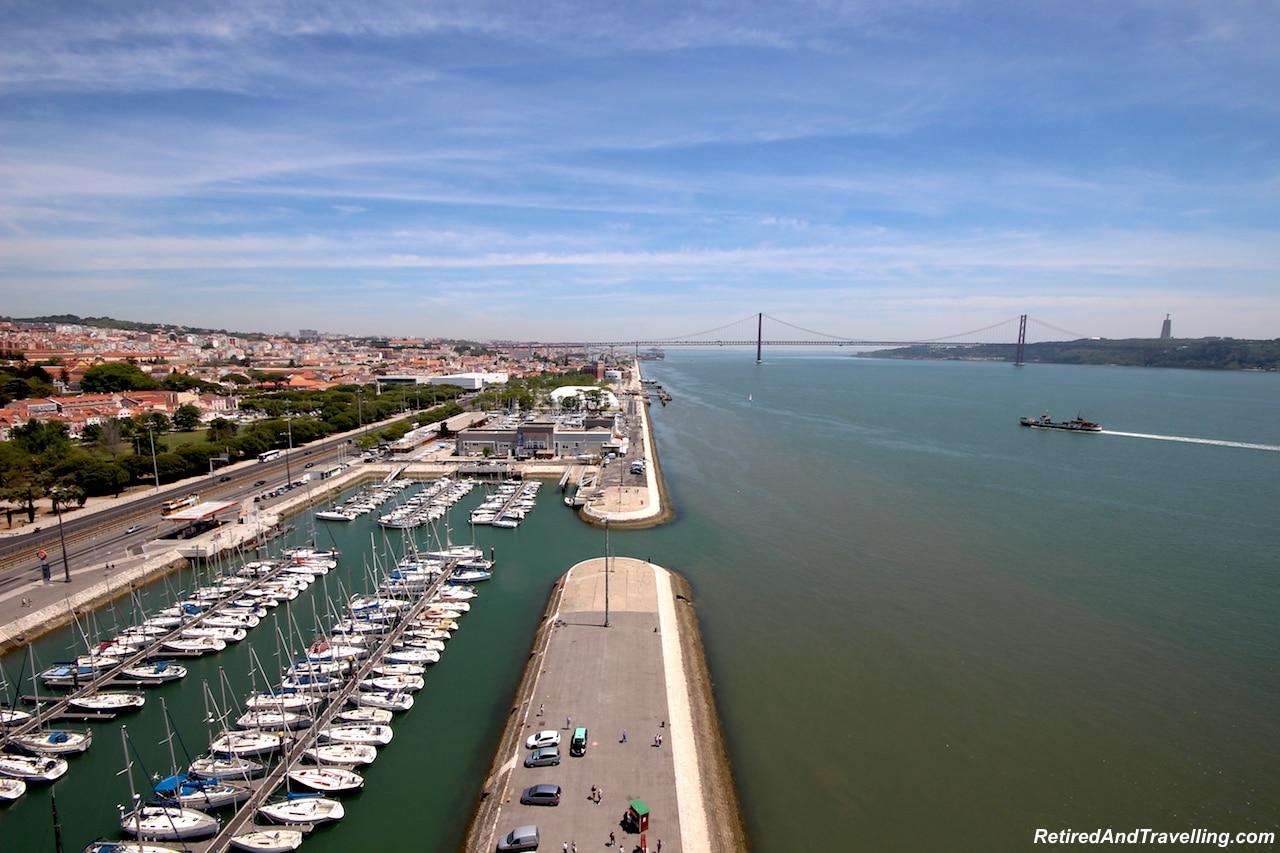 Padraodos Descobrimentos/Monument of Discoveries View of April 25 Bridge - Explore The Belem Area of Lisbon.jpg