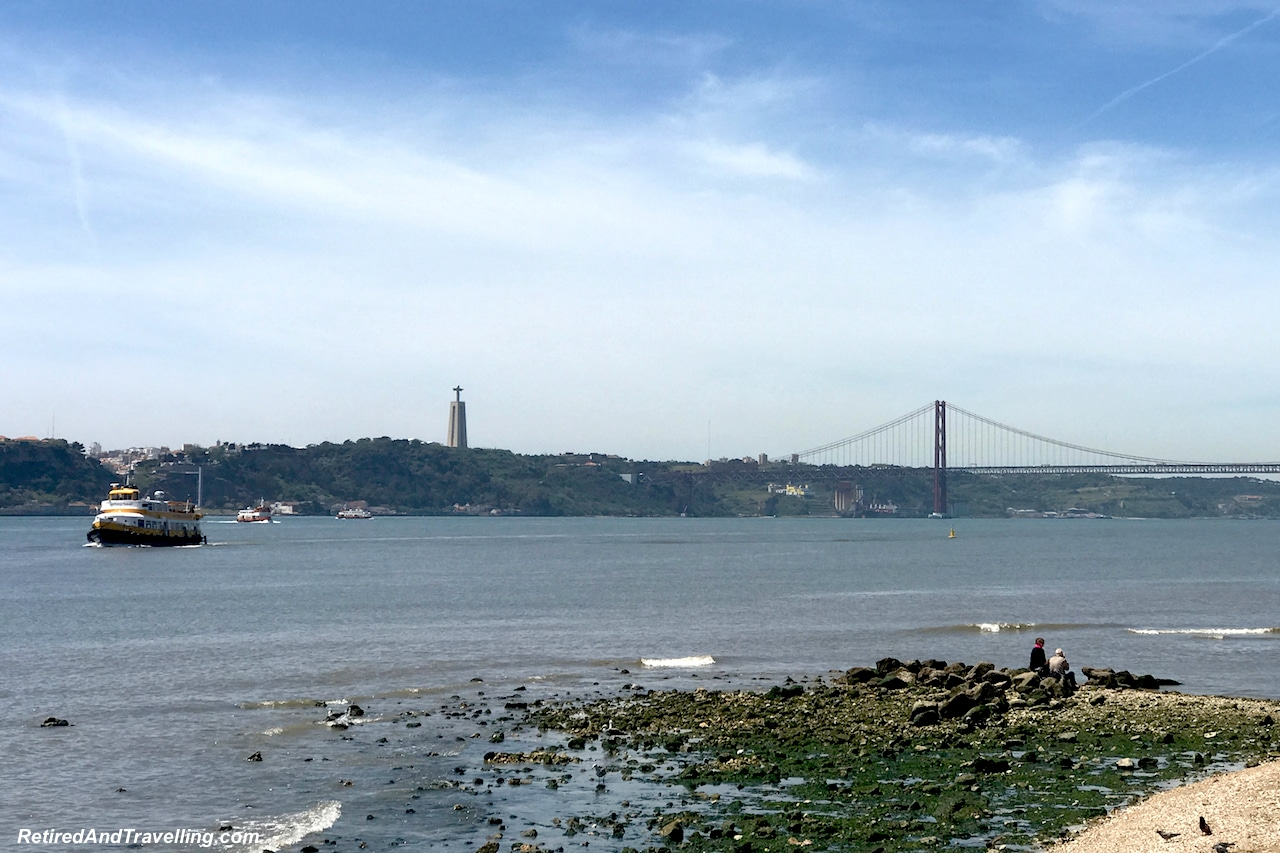 Commercio Waterfront view to April 25 Bridge- Walking in Lisbon Down The Avenida da Liberdade.jpg