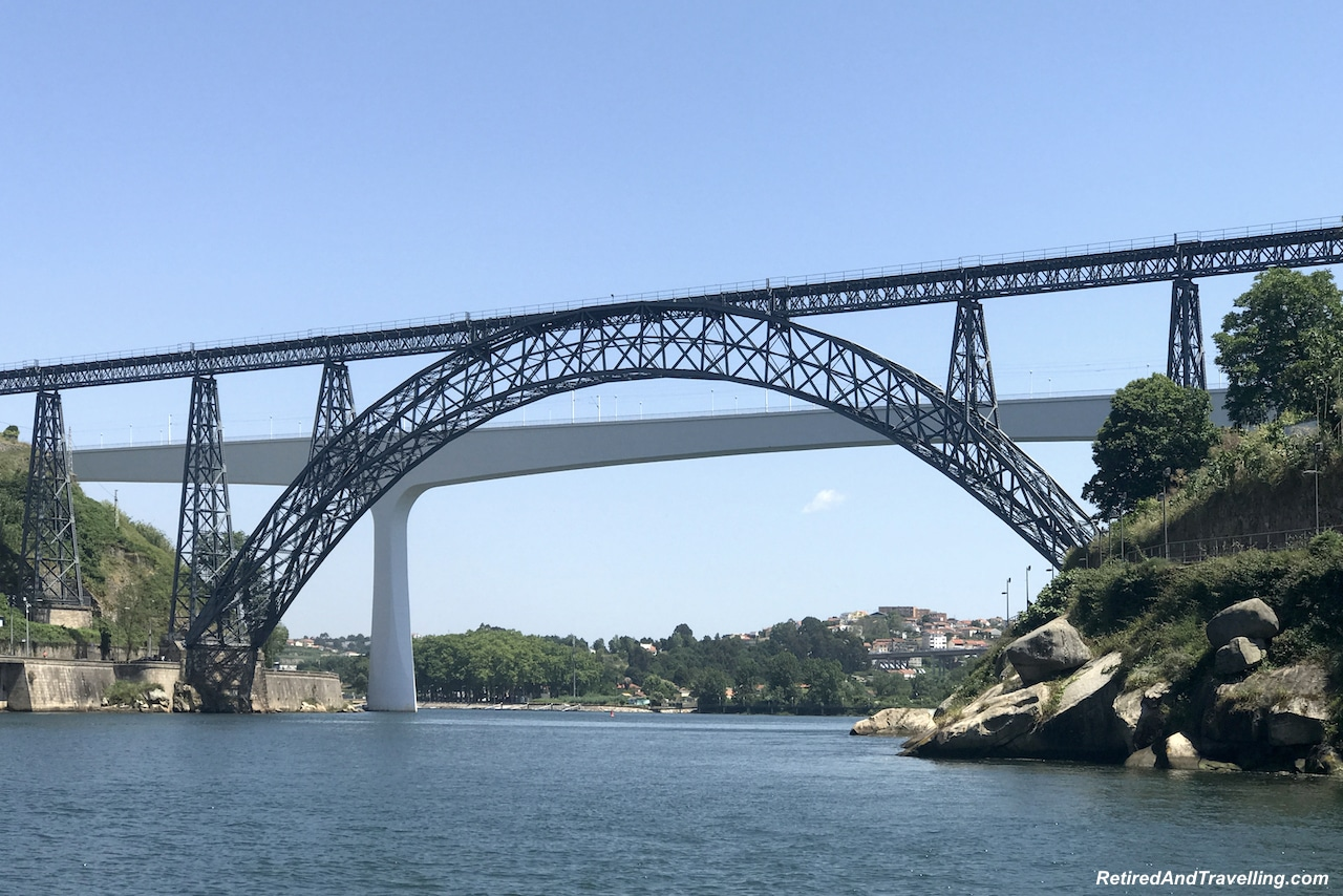 Ponte De D. Maria Pia and Ponte De S. Joao - Cruise The Douro River in Porto.jpg